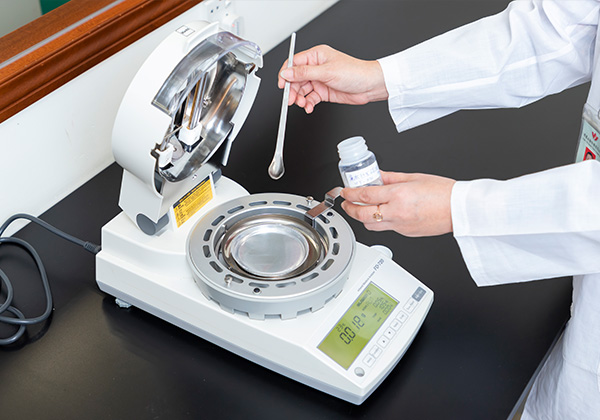 a tester is conducting careful chemical analysis